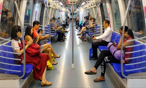 Subway interior with passengers.